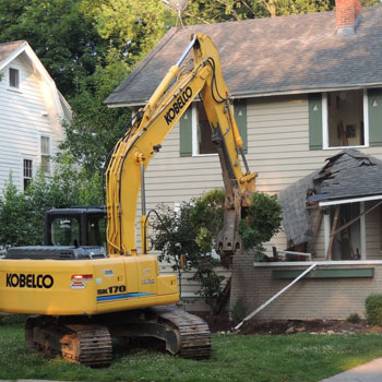 Selective demolition being done to front porch