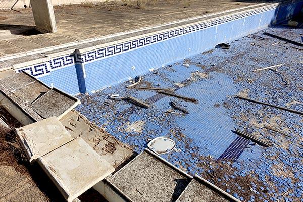 Demolition-of-inground-blue-tiled-pool